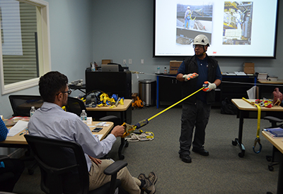 INstructor showing length of rigging in authorized person comprehensive course